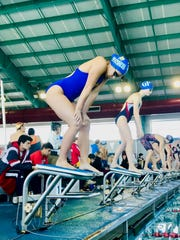 San Diego girls team captain Alex Gonzalez prepares for the start of a race at the District 30-5A swim meet at CCISD Natatorium.