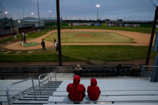 People sit in the stands and watch as the Calallen baseball team run drills during practice on Wednesday, Jan. 20, 2019.