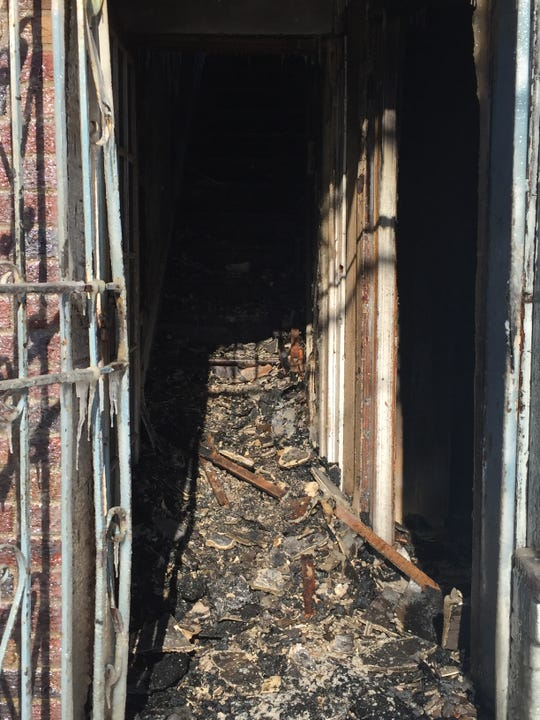 Charred rubble blocks the stairway to the second floor of a rowhome that burned early Thursday on Chestnut Street in Camden.