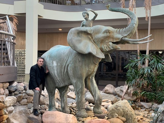 Sculptor Zenos Frudakis stands by his first large sculpture mounted inside the vacant Burlington Center Mall for more than  30 years.  The mall owner is donating the elephant statuary to the New Jersey Arts Guild for relocation to Burlington City,  possibly on the Delaware River waterfront.