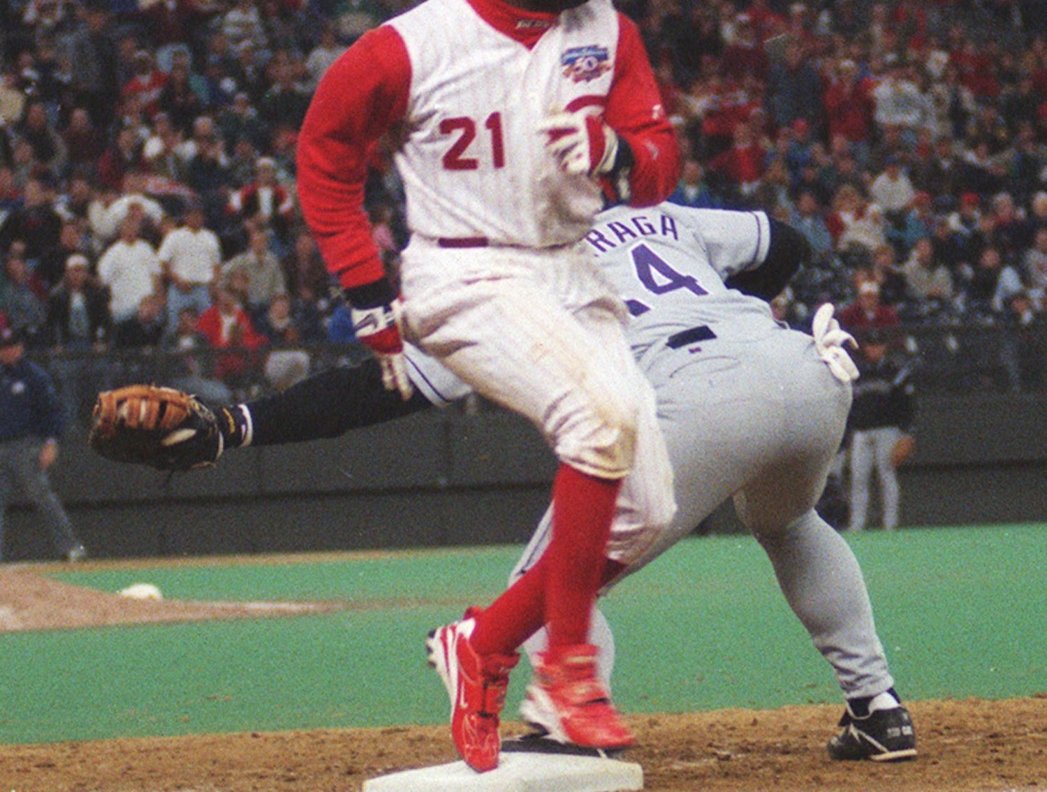 Text: reds- deion--4-2-97-- cincinnati reds deion sanders beats out the throw to first baseman andres galarraga in the 8th inning to pick up deion 4th hit of the night to go 4 for 5 on the night.c-e photo by ernest coleman for sports.