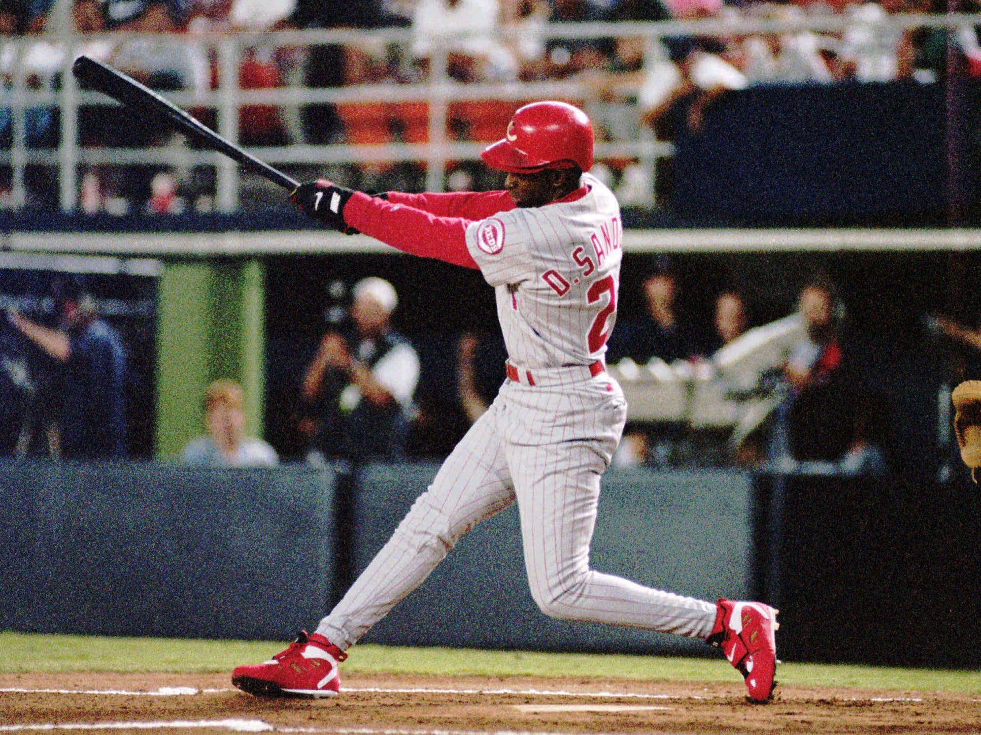 Cincinnati Reds' Deion Sanders takes a rip at the first pitch of the game against the San Diego Padres on July 17, 1995, in San Diego. Sanders is going to be a full-time football player this year, but said Tuesday, Feb. 20, 1996 he didn't rule outplaying baseball again.  ``I made this decision for the love of football, my family and for the city of Dallas,'' he said. ``Now I can find out just how good a football player I can be playing in two positions.''  (AP Photo/Mike Poche, file)