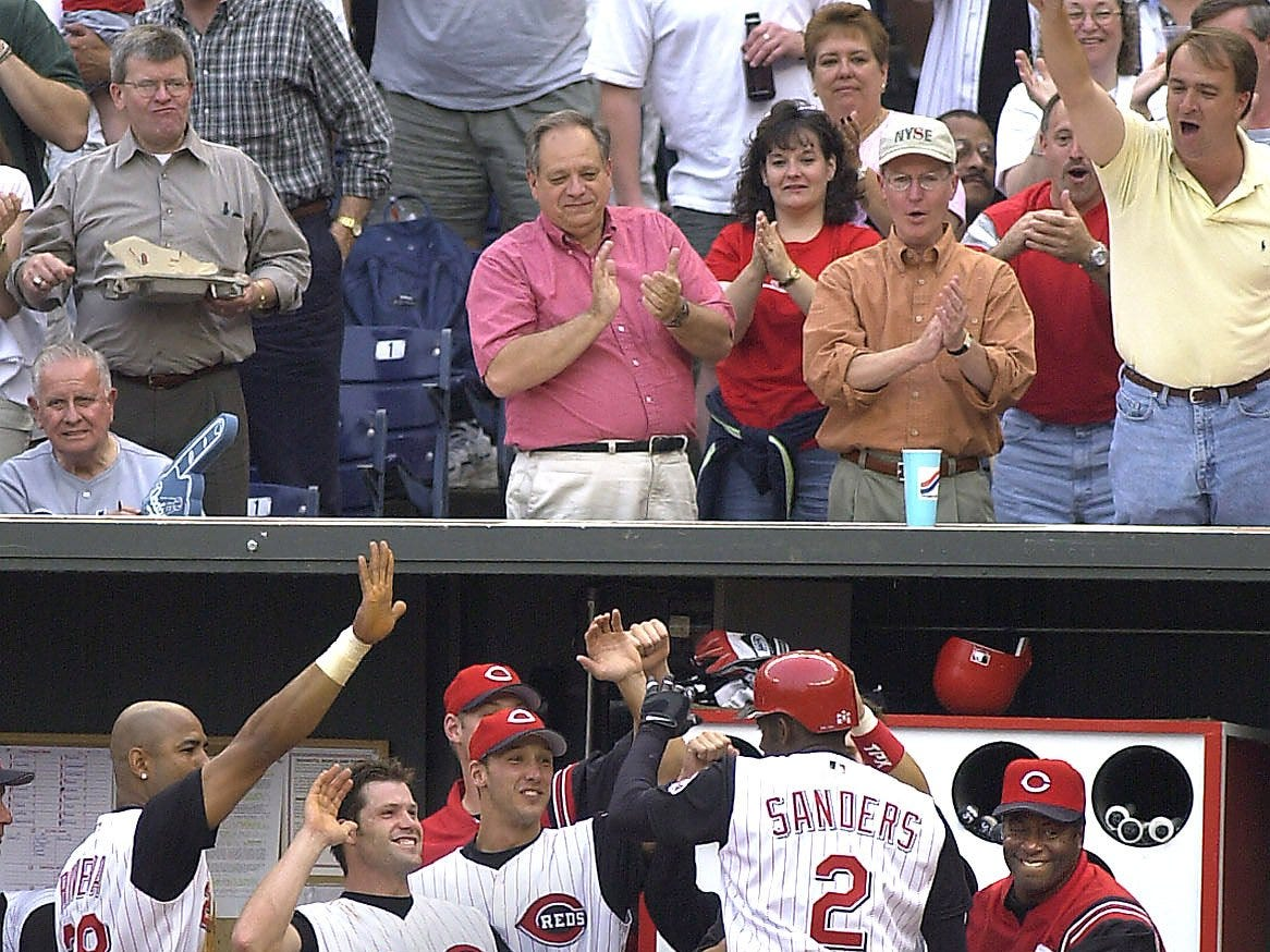 Text: 2001.0501.10.1--DEION RETURNS--Deion Sanders is greeted by an elated dugout after he hit a three-run homer against Los Angeles at Cinergy Field Tuesday May 2 in the second inning. Sanders returned to the Reds and the majors today after several seasons and other careers. Photo by Craig Ruttle/Cincinnati Enquirer