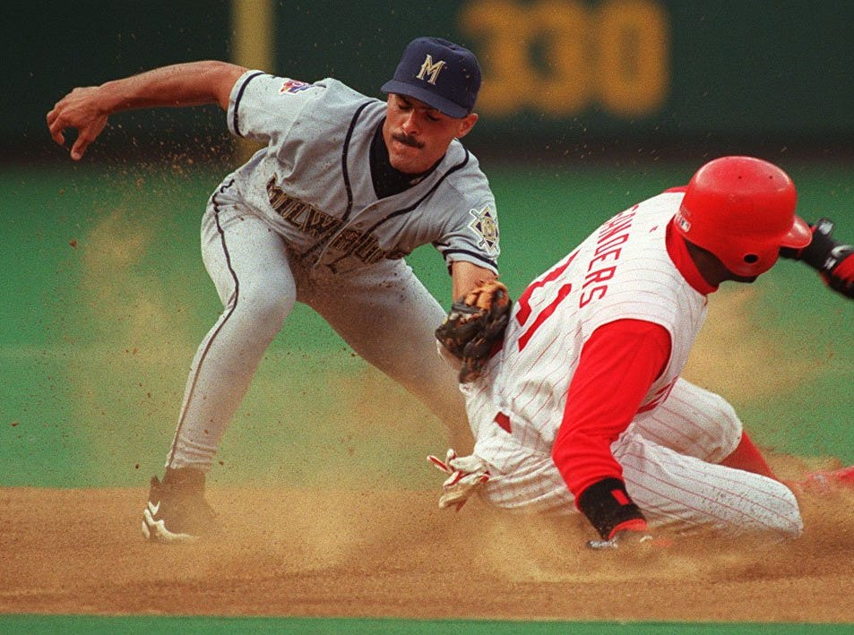 Text: 1997.0701.10.2--Reds/Sanders--Reds outfielder Deion Sanders steals second in the second inning at Cinergy Field Tuesday night. Brewers infielder Jose Valentin can't make the tag in time. photo by Craig Ruttle/Cincinnati Enquirer