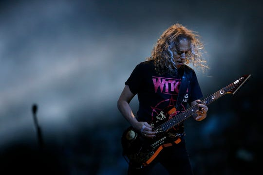 Metallica guitarist Kirk Hammett performs at US Bank Arena during the Cincinnati stop of the World Wired Tour on Wednesday, Jan. 30, 2019.
