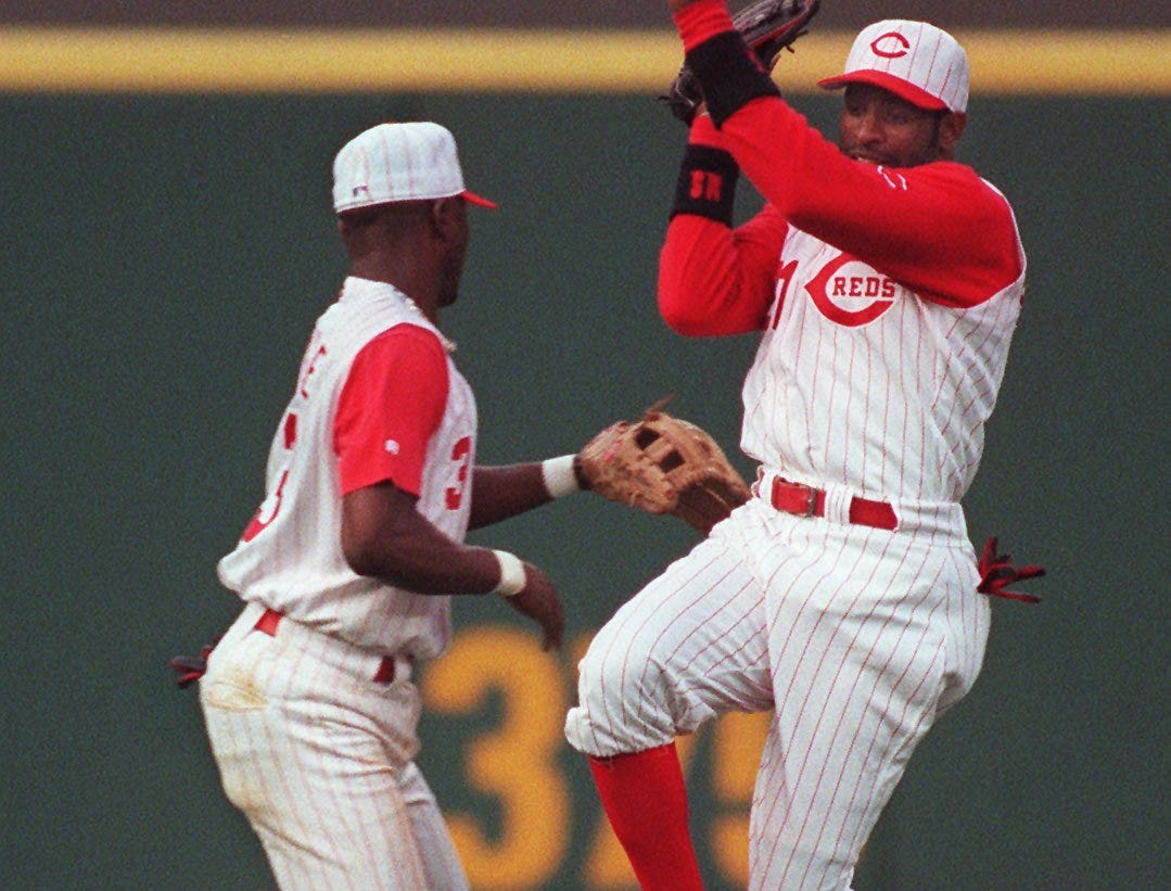 Text: 1997.0712.13.01 REDSReds Pokey Reese and Deion Sanders almost collide in the outfield trying to catch a ball hit by Montreal Expo FP Santangelo in the 4th inning. Photo by Ernest Coleman/The Cincinnati Enquirer mrb