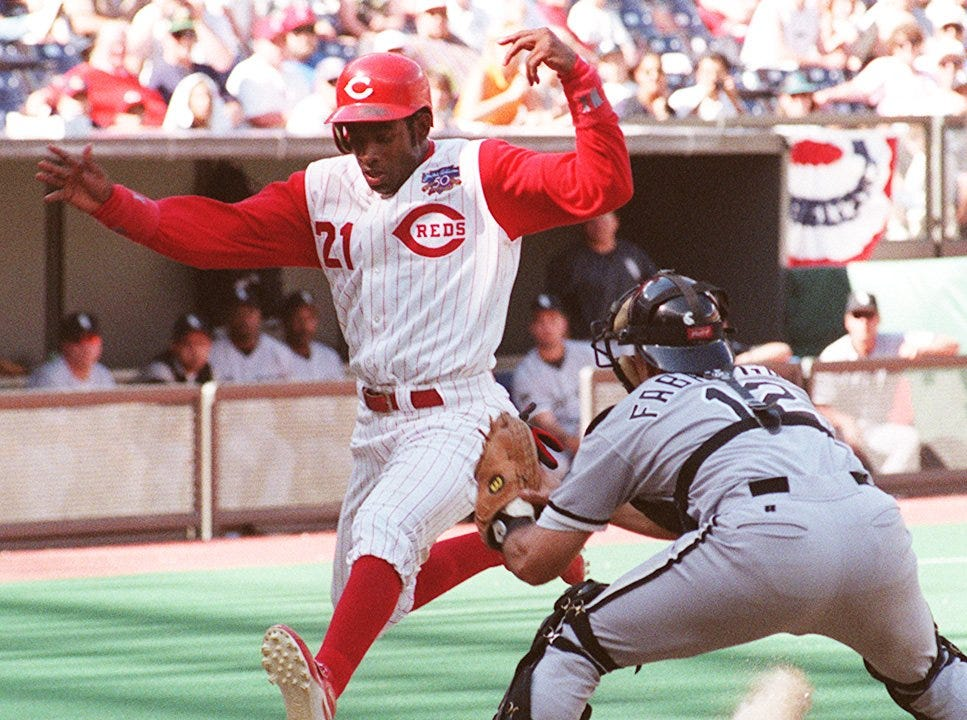 Text: 1997.0615.08.1-REDS-The Reds' Deion Sanders attempts to jump past White Sox catcher Jorge Fabregas after tagging from third base on a seventh inning pop fly Sunday. Sanders was out, and the Reds lost 14-6. Photo by Kevin J. Miyazaki/Cincinnati Enquirer.km