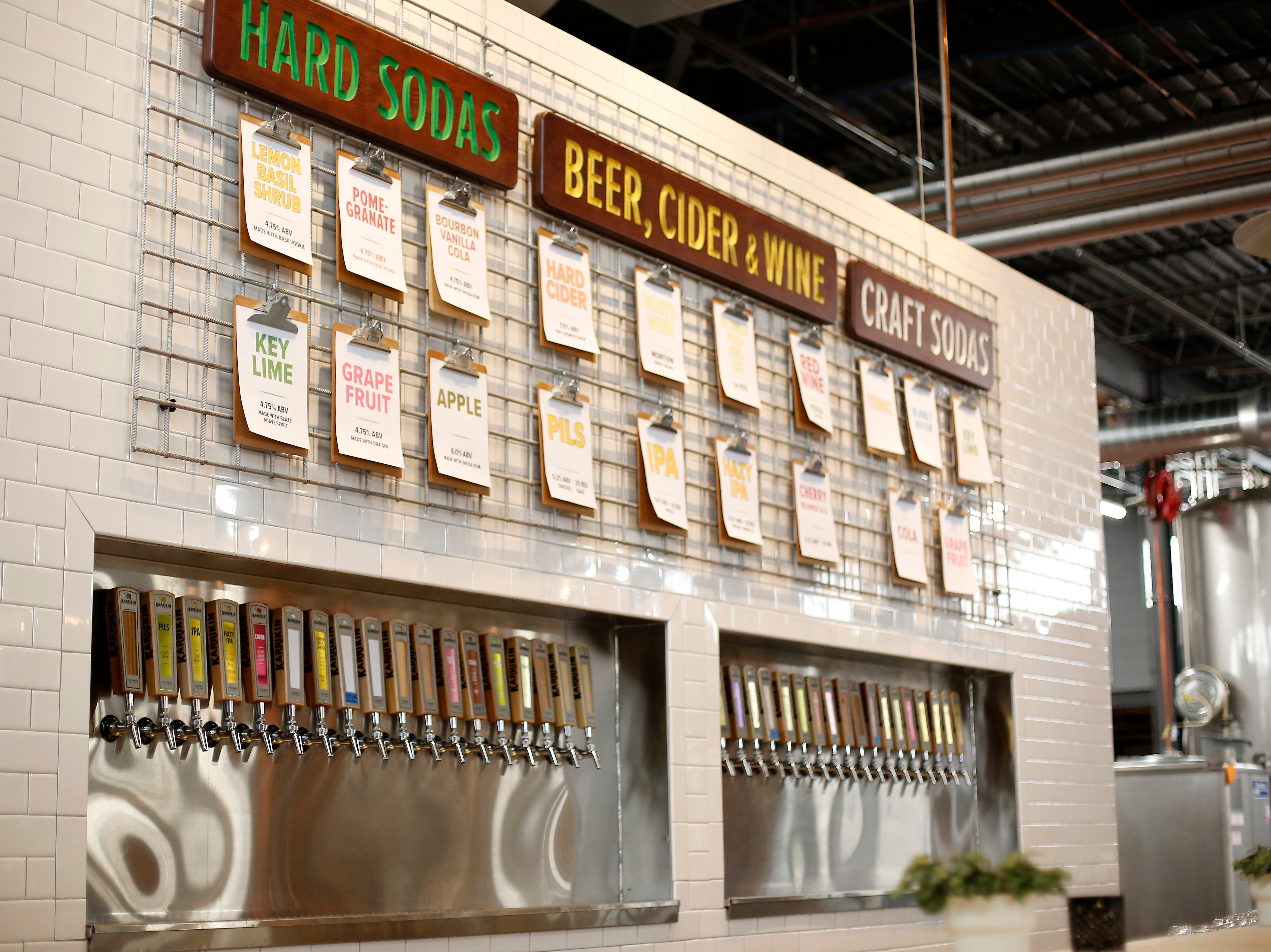 The main set of taps with hard soda, beer, ciders, wines and craft sodas on tap at Karrikin Spirits Co. in the Fairfax neighborhood of Cincinnati on Thursday, Jan. 31, 2019.
