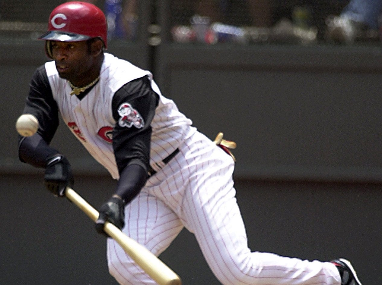 Text: 2001.0528. 14 -- REDS -- Cincinnati Reds Deion Sanders bunted a pitch at the bottom of the 6th inning. The Reds lost to the Cubs 9-6 in 13 innings. Yuli Wu/ Cincinnati Enquirer YW
