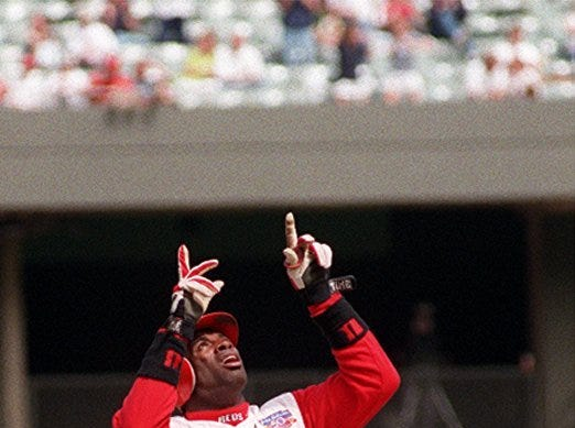 Text: Reds Sander--4-226-97--- Cincinati Reds Deion Sanders look up to the sky after hiting a Triple in the 8th inning of play during game with the Philadelphia Phillies.C-E photo by Ernest Coleman for sports.