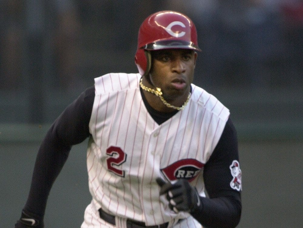 Text: 2001.5.29.12.2 REDS-SPORTS: Cincinnati Reds Deion Sanders on his way to first for a double in the 3rd inning of their baseball game against the Chicago Cubs at Cinergy Field Tuesday May 29, 2001. The Cincinnati Enquirer / Brandi Stafford .bs.