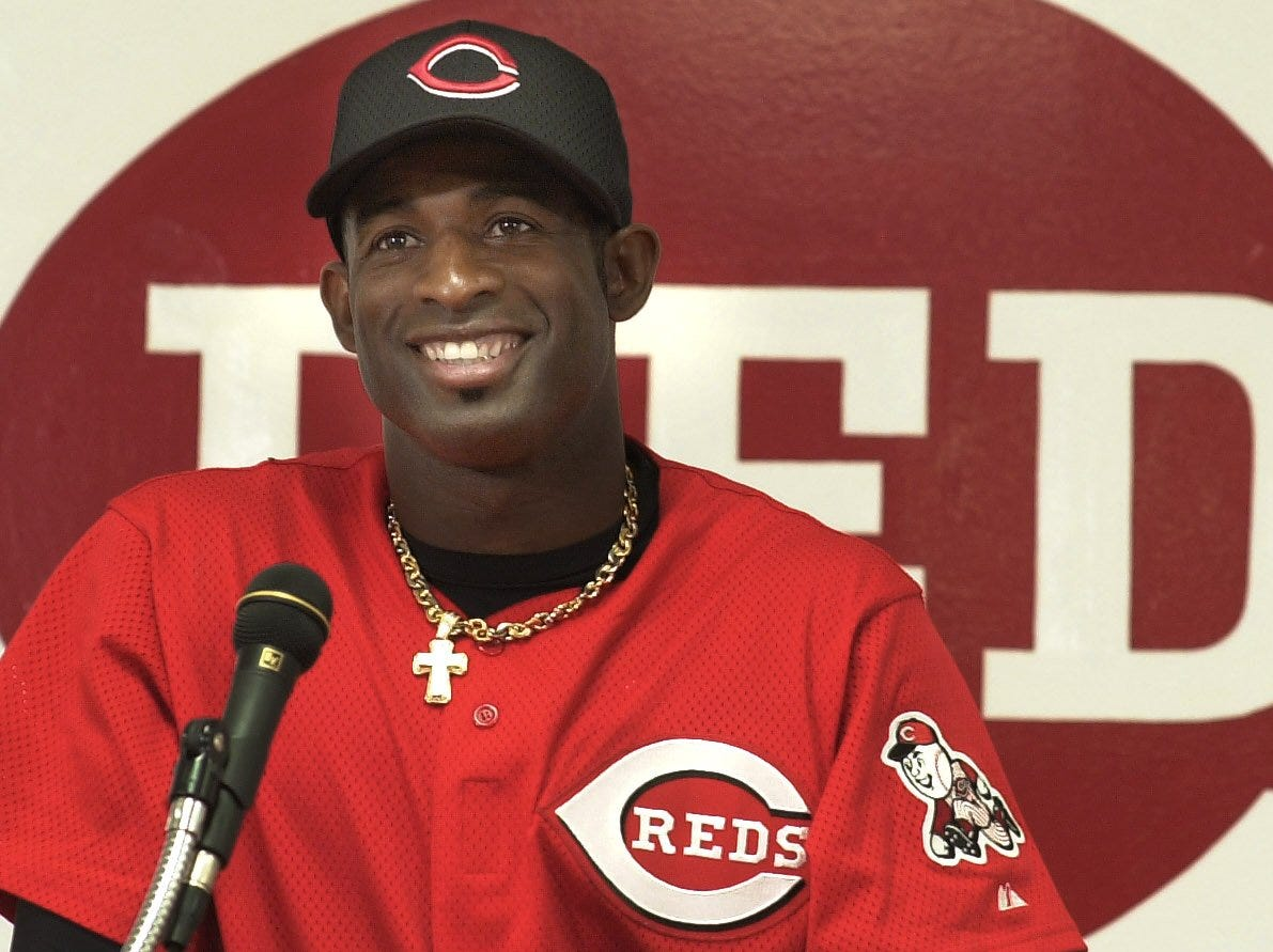 Text: 2001.0501.10.1--DEION RETURNS--Deion Sanders smiles during a press conference at Cinergy Field Tuesday May 2, that announced his return to the Cincinnati Reds. Sanders returned to the Reds and the majors after several seasons and other careers. Photo by Craig Ruttle/Cincinnati Enquirer