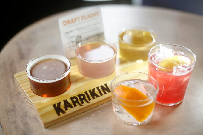 """The """"Watch Ya Step, Kid"""" (left) and """"I'm Flying"""" with a flight of beers at Karrikin Spirits Co. in the Fairfax neighborhood of Cincinnati on Thursday, Jan. 31, 2019."""