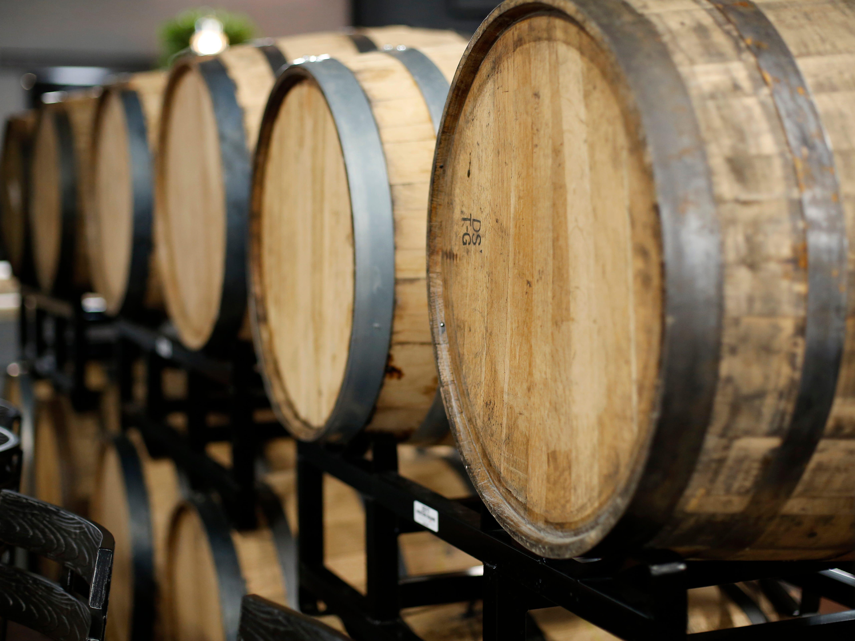 Barrels are stacked at Karrikin Spirits Co. in the Fairfax neighborhood of Cincinnati on Thursday, Jan. 31, 2019.