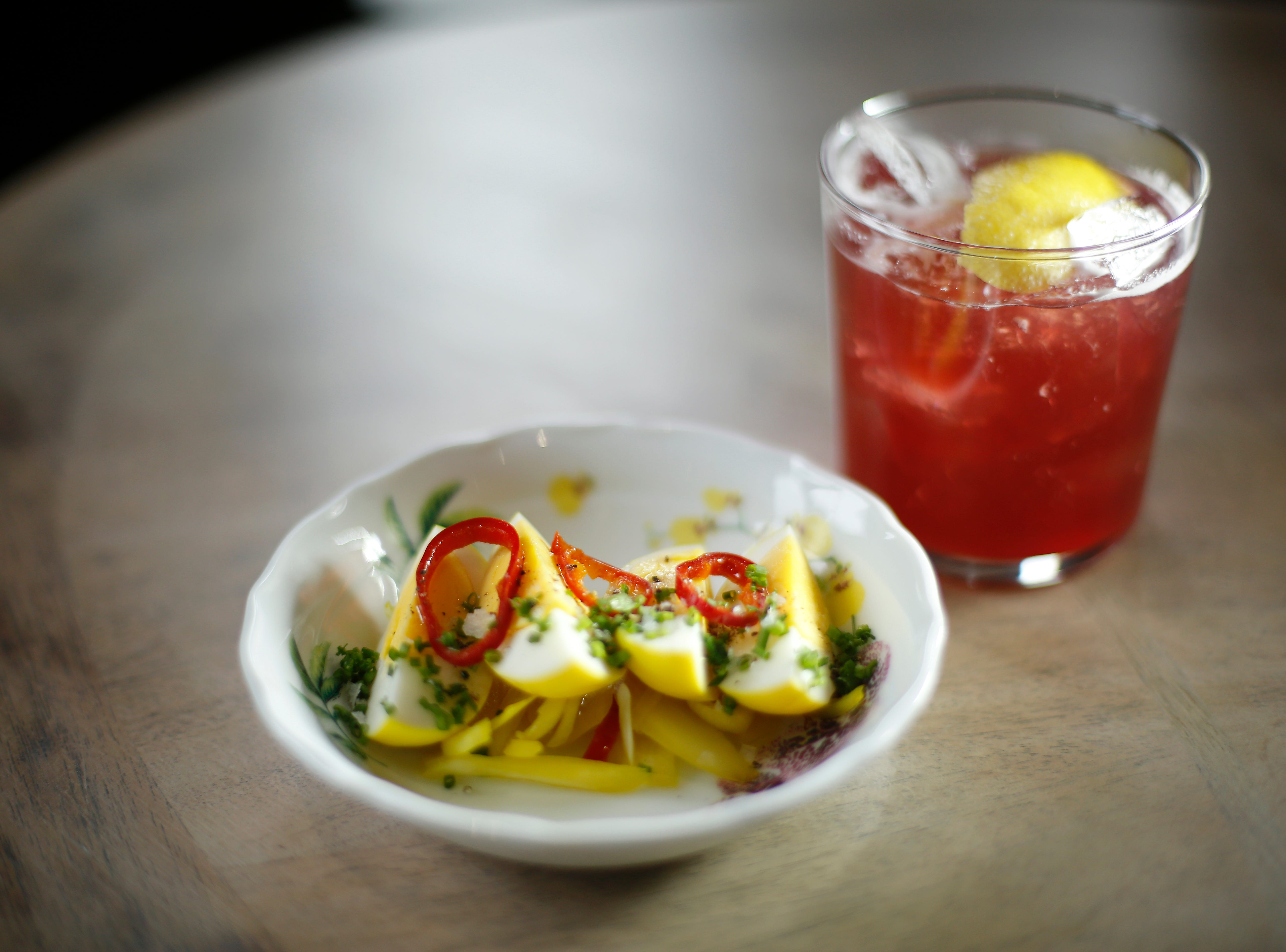 """An order of Mustard Pickled Eggs with an """"I'm Flying"""" cocktail at Karrikin Spirits Co. in the Fairfax neighborhood of Cincinnati on Thursday, Jan. 31, 2019."""
