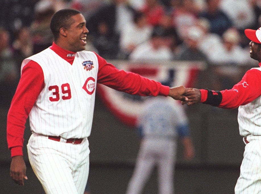 Text: 1997.0903.10.Reds-2-- Eduardo Perez kids around with Reds Deion Sanders after Perez hits in two runs in he 2th inning of play with Kansas City.C-E photo by Craig Ruttle.