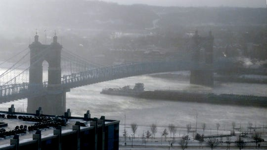 A barge passed under the Roebling Suspension Bridge on the Ohio River Wednesday.