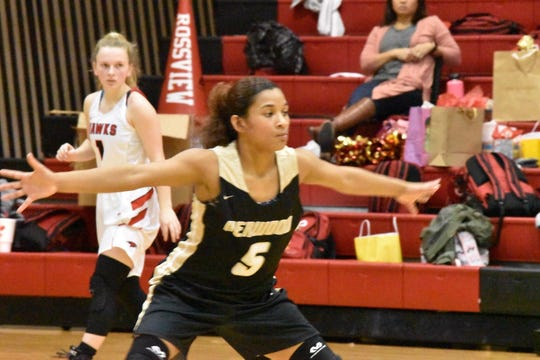 Kenwood's Jalea Blackman (5) guards her position against Rossview during a district basketball game earlier this season. Blackman was named Athlete of the Week in Clarksville.