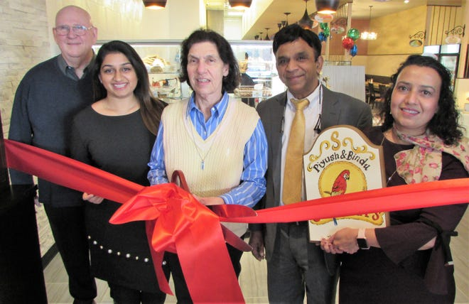 Mayor Janice S. Mironov and Council Member Alan Rosenberg join with owner and founder Piyush Sukhadia, and company management to cut the ribbon to celebrate the grand opening of Sukhadia's restaurant in the East Windsor Village Shopping Center.