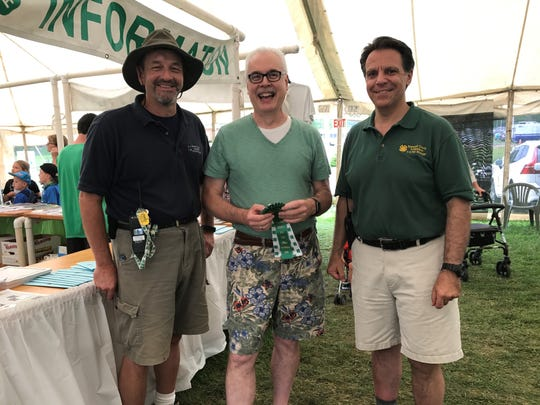 The Courier News / Home News Tribune / MyCentralJersey.com have participated in the Somerset County 4-H Fair for years, taking a table in the Commercial Vendors tent. It is one of the ways we are part of the community. In 2017, we received a ribbon for our work – I am pictured with two of the fair managers, Walker Graham,  left and Mike Pappas, right.