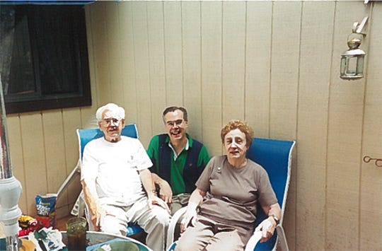 Here I am with my father, Joseph, and my mother, Rose, in 2001.