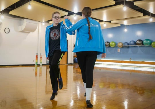 Carl Tubbs, 13, of Des Moines dances an Irish jig with his sister, Julia, on Tuesday, Jan. 30, 2019, at the Walnut Creek YMCA in Des Moines. Tubbs has stuck with it despite being bullied by school classmates and has even struck up a friendship with professional football player Alex Collins, running back for the Baltimore Ravens, who uses Irish dancing to help improve his footwork.
