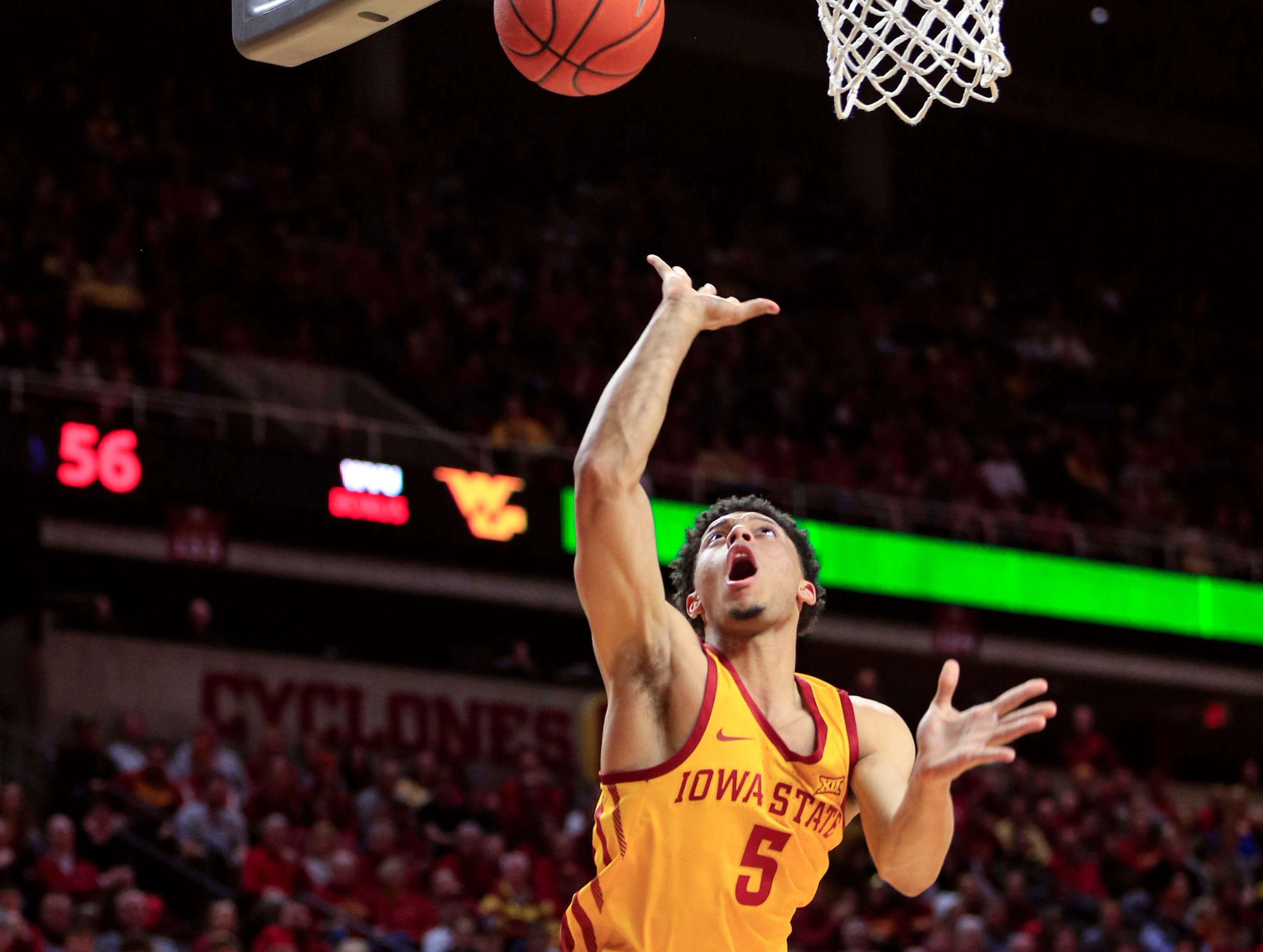 Iowa State's Lindell Wigginton drives to the basket during a game against West Virginia at Hilton Coliseum Wednesday, Jan. 30, 2019.