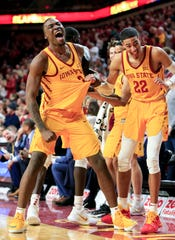 The Iowa State bench celebrates a basket during a game against West Virginia at Hilton Coliseum Wednesday, Jan. 30, 2019.