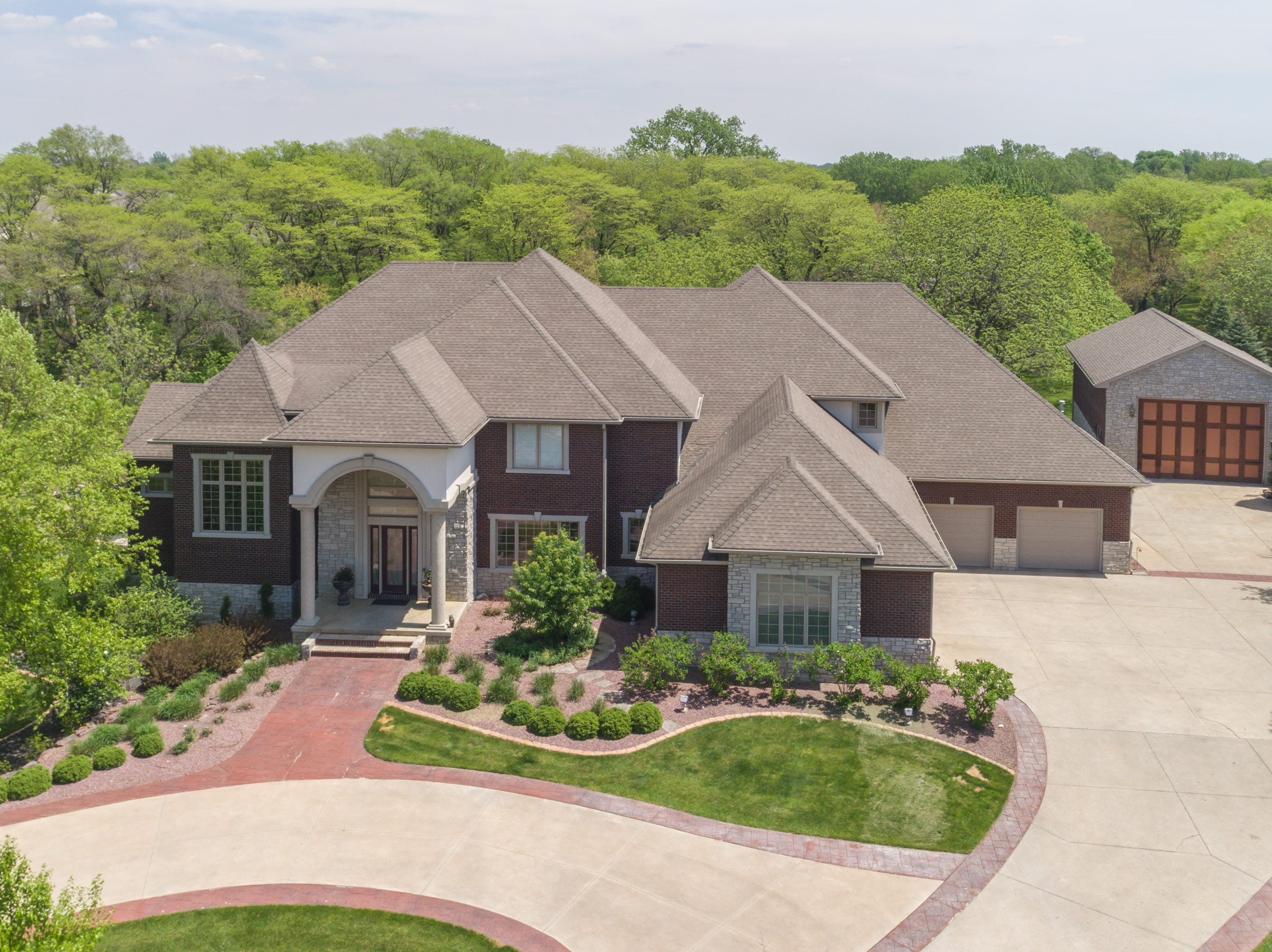 This home on Northeast Delaware Avenue in Ankeny sold for $1.05 million in 2018. It has a five-car heated garage, swimming pool, indoor basketball court and eight bathrooms.