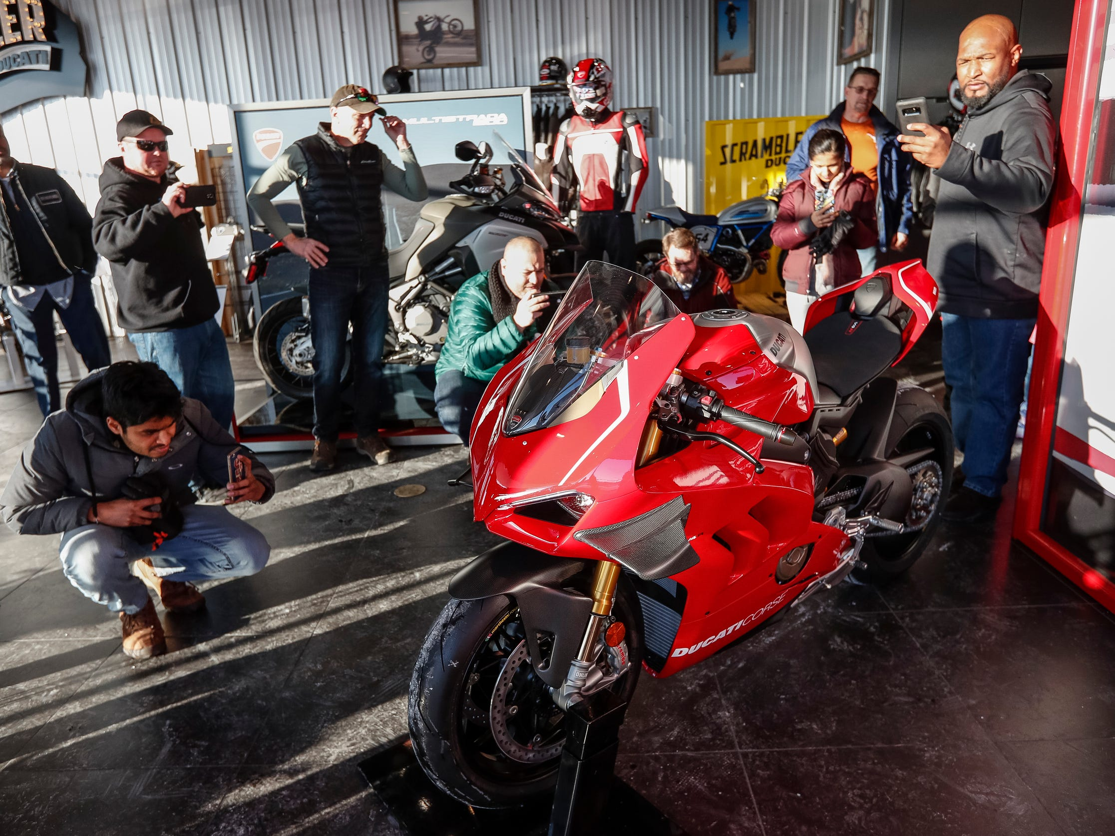 Motorcycle fans take photos and videos as the Ducati 2019 Panigale V4 R on display at Ducati Detroit in Birmingham, Wednesday, Jan. 30, 2019.
