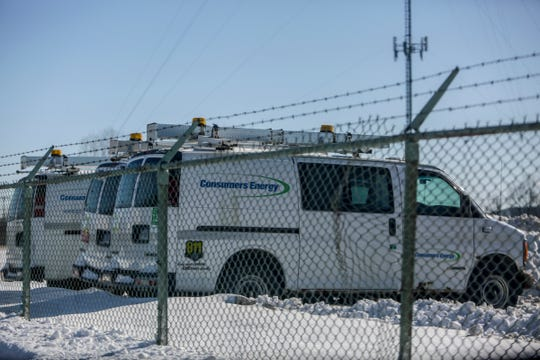 Service trucks sit in the back parking lot of the service center for Consumers Energy in Clinton Twp., Mich. on Thursday, Jan. 31, 2019. Consumers Energy sent out a text alert asking the public to turn their thermostats to 65 degrees due to strains on their natural gas resources.