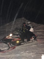 Andrea Cusack, pharmacist and owner of Lake Odessa Pharmacy, delivered prescriptions to customers on a snowmobile Tuesday, Jan. 29, 2019. Cusack's 15-year-old son drove the snowmobile.