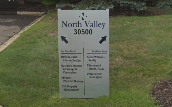 The entrance sign at 30500 Northwestern Hwy. in Farmington Hills, Michigan references the University of Farmington, a fake university created by ICE to lure students as part of an undercover sting operation.