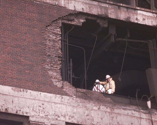 Building inspectors walk past an upper level wall that was may have been an explosion point at the Powerhouse building on the Ford Rouge grounds, Thursday, February 04, 1999.