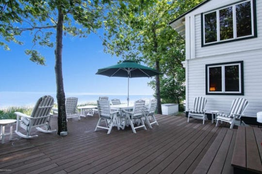 This $1.75M dream home on Lake Michigan offers up a private beach on 300 feet of waterfront