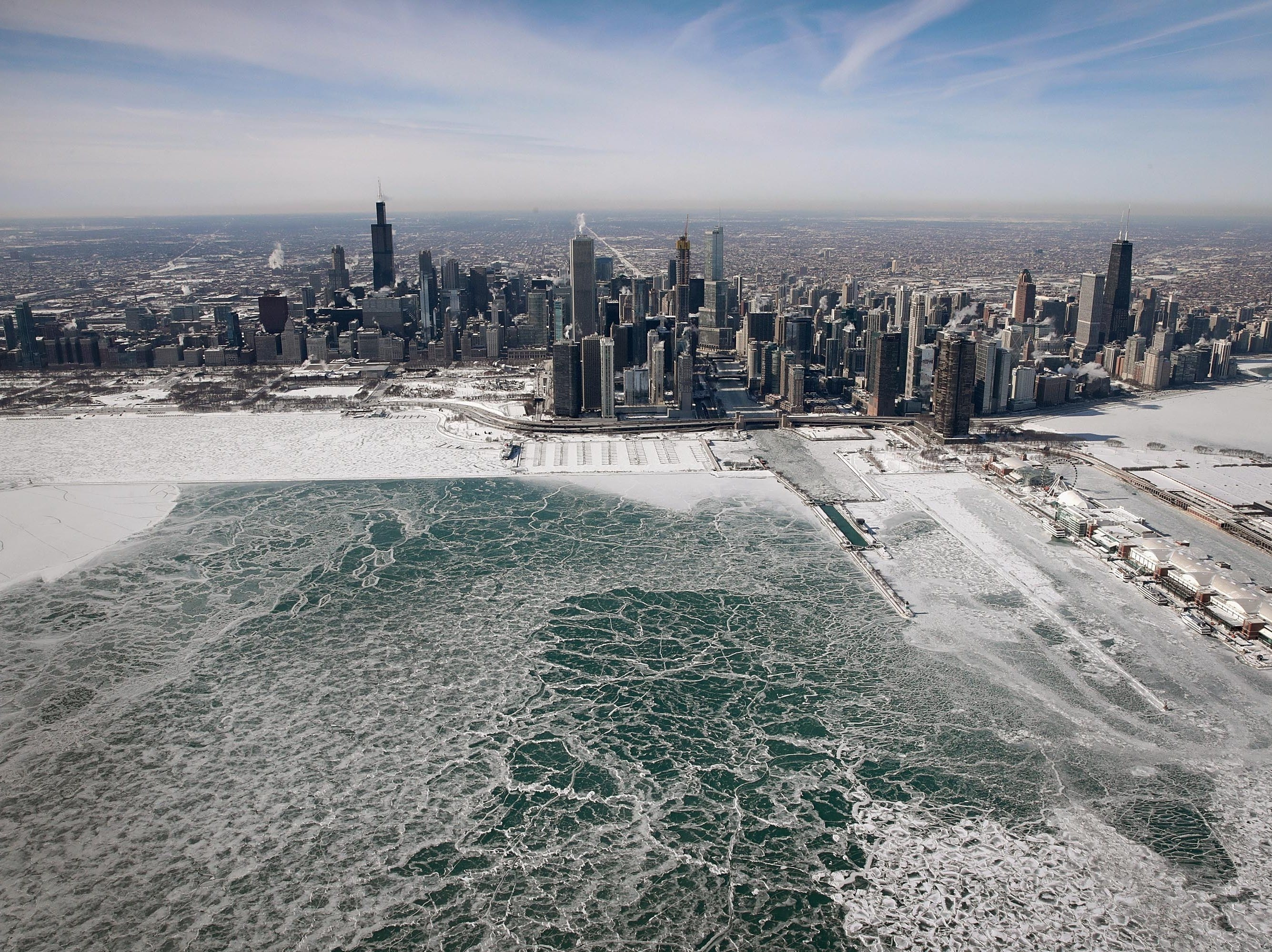 Ice builds up along the shore of Lake Michigan as temperatures during the past two days have dipped to lows around -20 degrees  on January 31, 2019, in Chicago, Illinois. Businesses and schools have closed, Amtrak has suspended service into the city, more than a thousand flights have been cancelled and mail delivery has been suspended as the city copes with record-setting low temperatures.