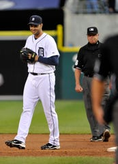 Tigers pitcher Armando Galarraga walks away from first-base umpire Jim Joyce (right) moments after Joyce's call denied him a perfect game. Joyce later admitted he had blown the call.