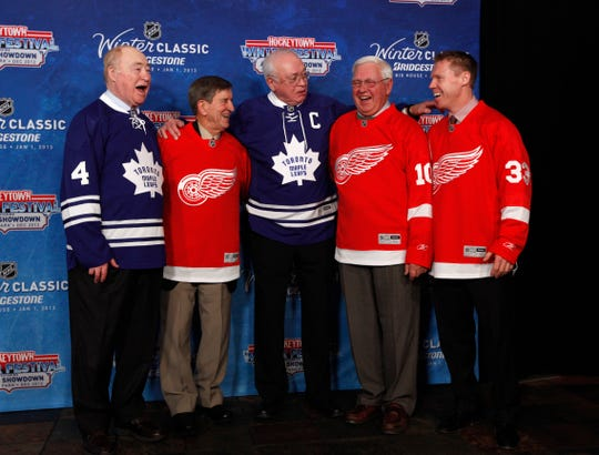 From left, Red Kelly, Ted Lindsay, George Armstrong, Alex Delvecchio and Kris Draper pose for photos during the announcement of the NHL Winter Classic hockey game at Comerica Park  in Detroit on Feb. 9, 2012.