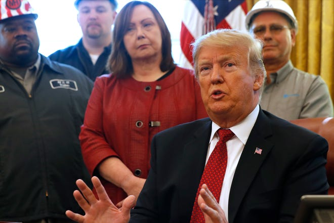 """President Donald Trump speaks during a meeting with American manufacturers in the Oval Office of the White House, Thursday, Jan. 31, 2019, in Washington. Trump was signing an executive order pushing those who receive federal funds to """"buy American."""""""