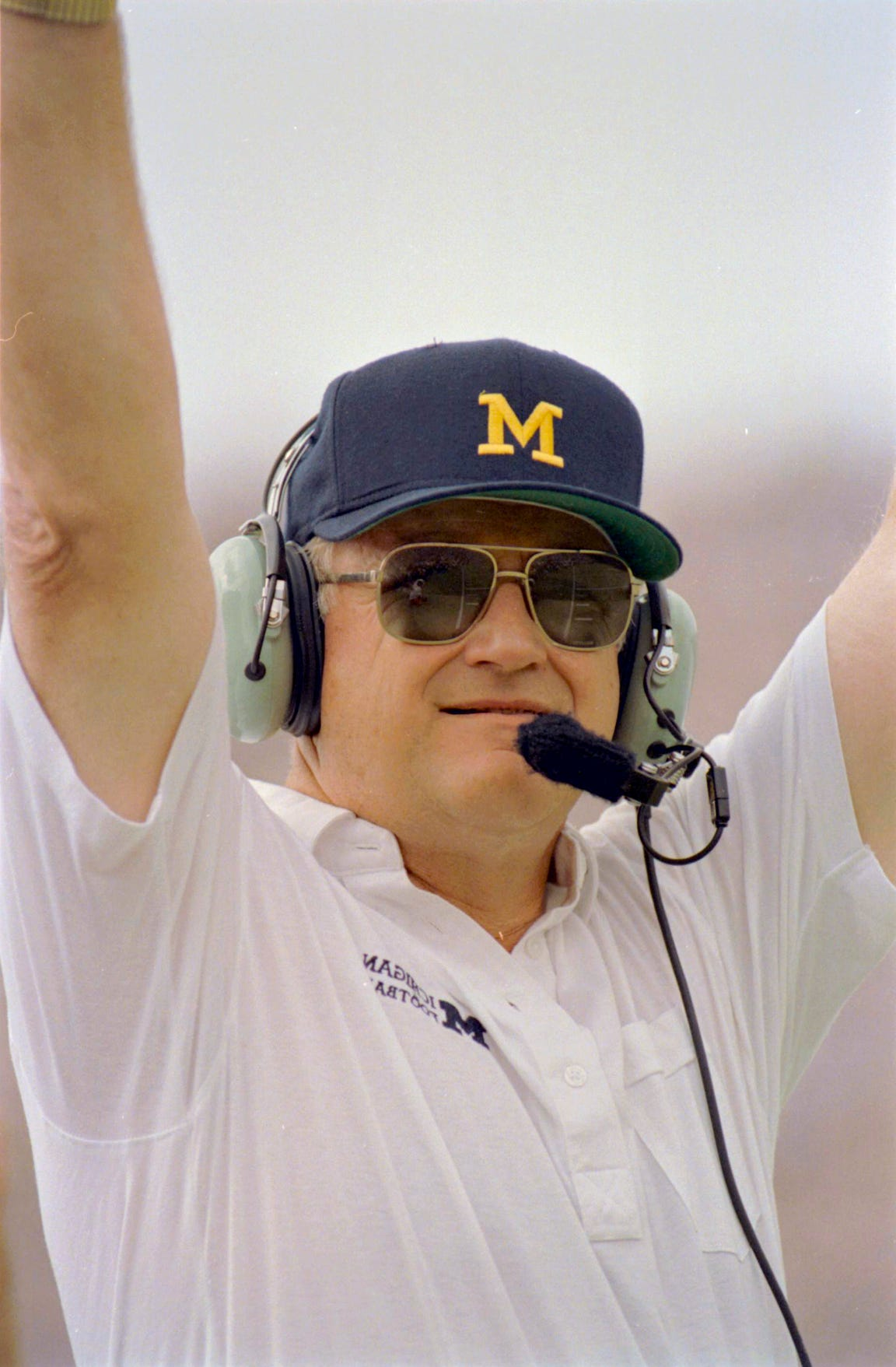 A one-time offensive lineman for Bo Schembechler at the University of Michigan, Hackett stresses teamwork within the sprawling automaker.