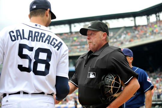 Umpire Jim Joyce shakes hands with Tigers pitcher Armando Galarraga after his blown call in the ninth inning cost the pitcher a perfect game the night before. Galarraga brought out the lineup card the following day.