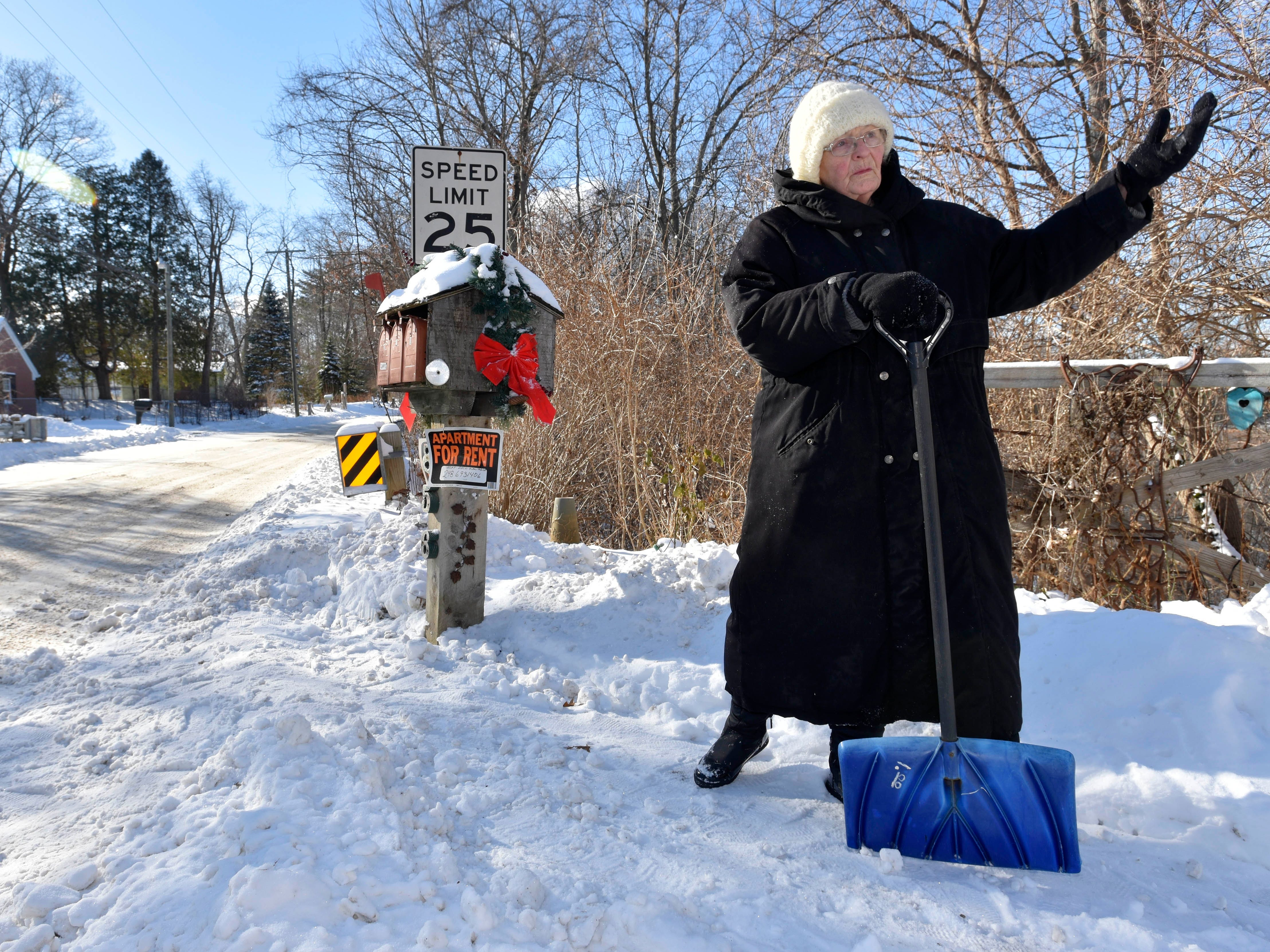 "When asked if she's gonna continue shoveling, Sandra Campos says with authority, ""give me a minute, I'm taking a break, I'm 80-years-old,"" before continuing to shovel out the mailboxes at her residence on Lake Orion near the Indianwood Golf and Country Club's 'Old Course,' (established in 1925.)"