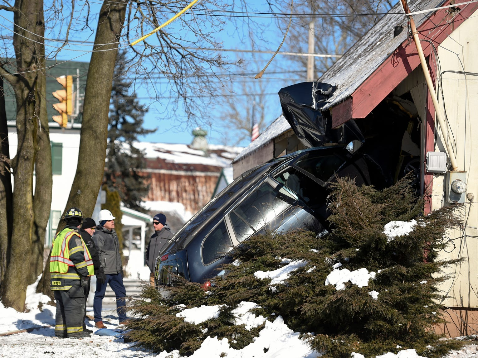 First responders are at the scene of a car that crashed into a building at 422 and Monocacy Creek Road Thursday, Jan. 31, 2019, in Amity Township, Pa.