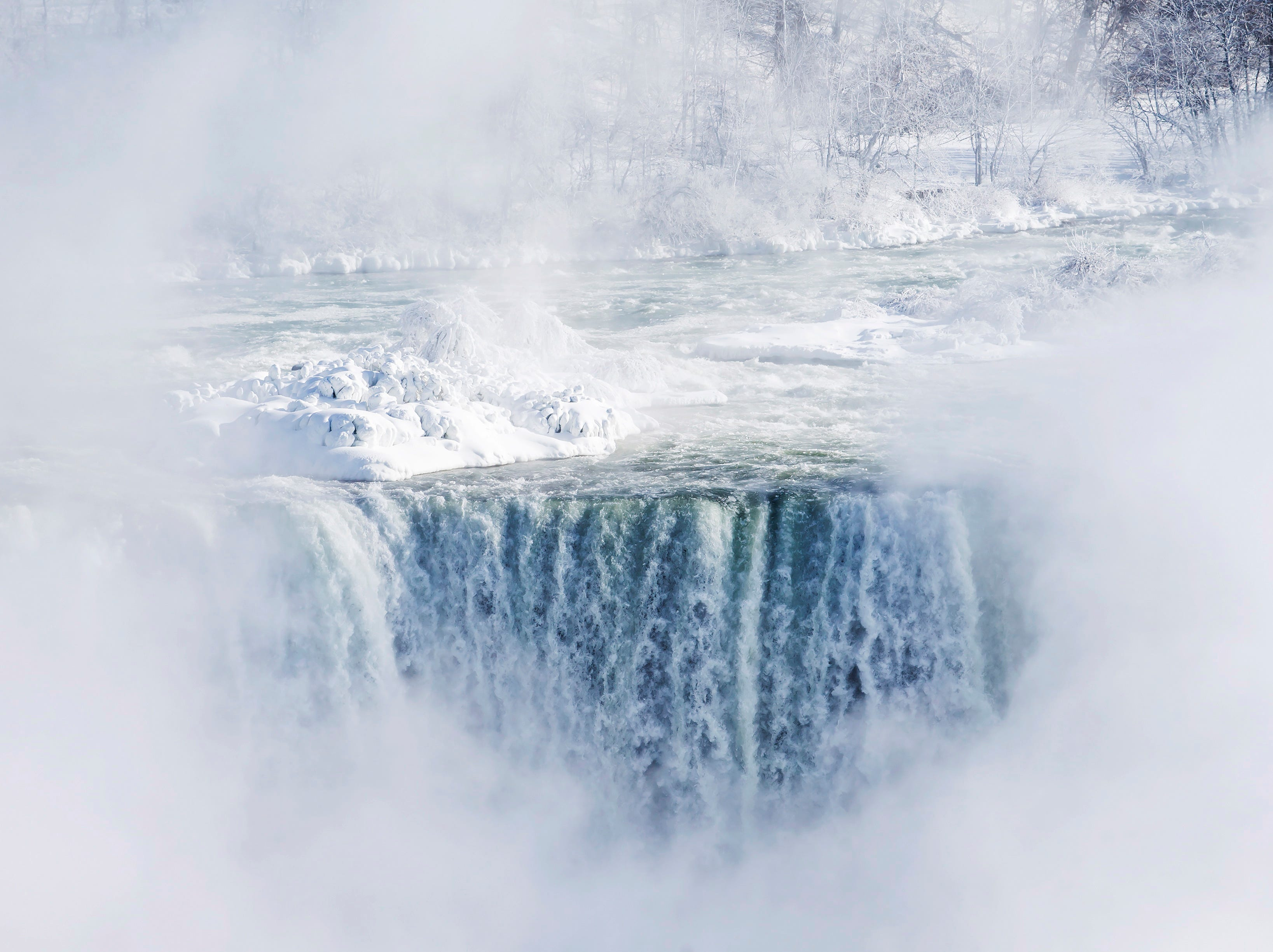 Ice and water flows over the brink of the Horseshoe Falls in Niagara Falls, Ontario, Canada Thursday, Jan. 31, 2019.