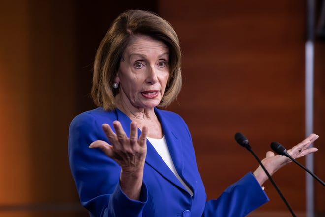 Speaker of the House Nancy Pelosi, D-Calif., talks to reporters during a news conference a day after a bipartisan group of House and Senate bargainers met to craft a border security compromise aimed at avoiding another government shutdown, at the Capitol in Washington, Thursday, Jan. 31, 2019.