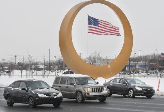 The Golden Corridor sculpture sits in the median of the divided highway of M-59, Hall Road, in Sterling Heights.