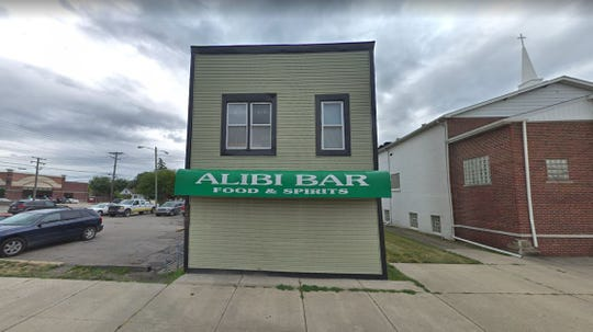 The officer was arrested after an incident at the Alibi Bar on East Nine Mile Road in Warren.