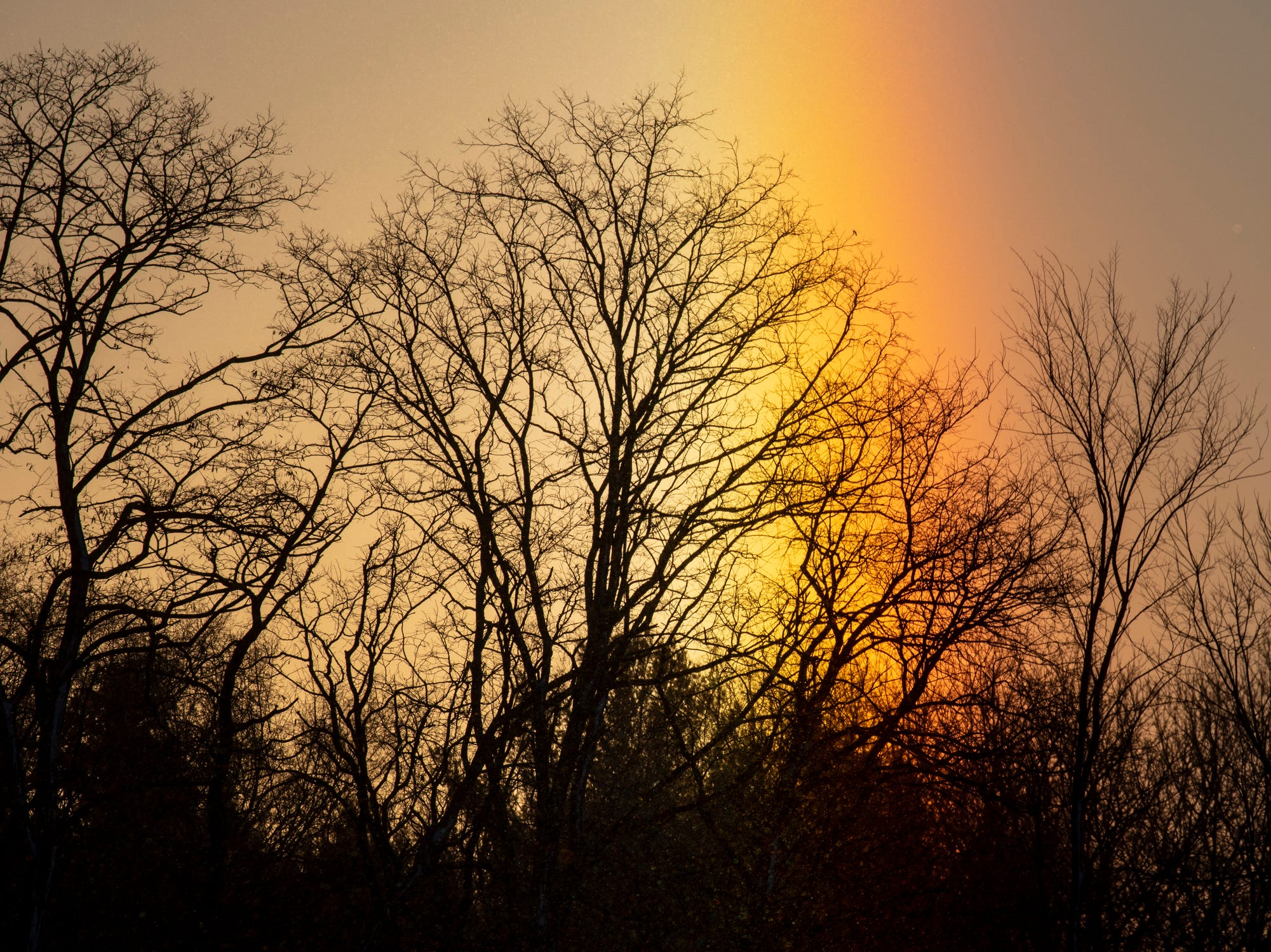 A sun dog appears in Kalamazoo, Michigan on Thursday, Jan. 31, 2019. Temperatures will be dangerously cold, with the wind chill index between -20 and -40 degrees.
