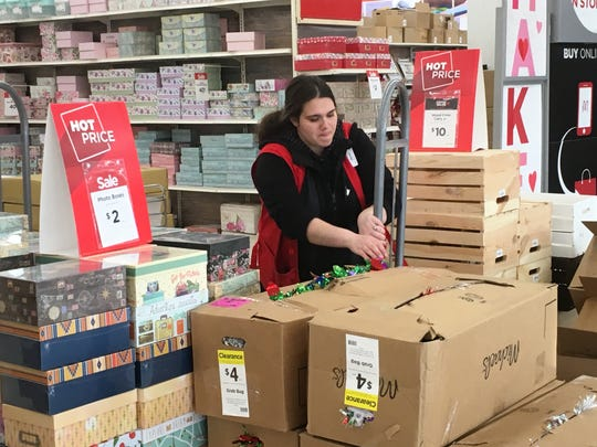 "Jenn Julian, 28, of Macomb, calls Sterling Heights' 35-foot aluminum circle ""kind of pointless, honestly."" She was packing up leftover Christmas supplies at the Michaels craft store near the installation on Hall Road."