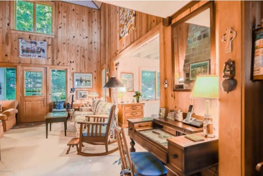 Inside, the cottage boasts a two-story living area with a stone, natural gas-fueled fireplace.
